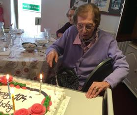 Rowleys member Annie Blunden - 104 years young - cuts her special cake at the centre - web